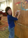 Sandi Awakawa Henry '74 putting up her Mod decorations!
